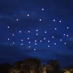 49 quadrocopters with lights roam the night sky in formation